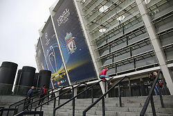 May 13, 2018 - Kiev, Ukraine - People takes pictures in front of NSC Olimpiyskiy covered with banners for the Champions League in Kyiv, Ukraine, May 13, 2018. Kyiv prepares to host UEFA Women's Champions League final between Wolfsburg and Lyon at Valeriy Lobanovskiy Dynamo Stadium on 24 May, 2018 and the UEFA Champions League final match between Real Madrid and  Liverpool at NSC Olimpiyskiy Stadium on Saturday 26 May, 2018. (Credit Image: © Sergii Kharchenko/NurPhoto via ZUMA Press)