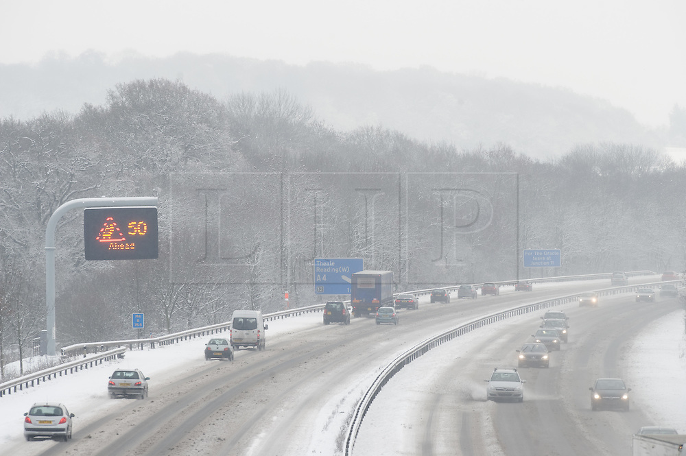 © under license to London News Pictures.  18/12/2010. Traffic battles through heavy snow along the M4 at junction 12 for Reading, Berkshire today (18/12/2010).  Severe weather is expected to hit the whole of the UK this weekend. Photo credit should read Sam Long/ London News Pictures