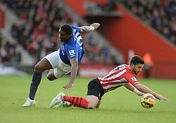 Everton's Sylvain Distin sends Southampton's Shane Long tumbling. - Photo mandatory by-line: Alex James/JMP - Mobile: 07966 386802 - 20/12/2014 - SPORT - Football - Southampton  - St Mary's Stadium - Southampton  v Everton - Football