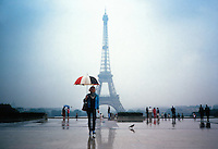 woman and red white and blue umbrella-eiffle tower