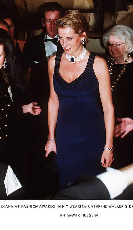 Diana, Princess of Wales wears a blue evining dress by designer Catherine Walker and a pearl and sapphire choker when she attends a fashion awards ceremony in News York, USA on January 31, 1995.<br />