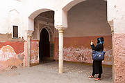 MARRAKESH, MOROCCO - 19TH APRIL 2016 - Tourist photographs the doorway to the Zaouia / zawiya burial tomb shrine site of Sidi Ben Slimane - Shaykh Muhammad ibn Sulayman al-Jazuli, Marrakesh, Morocco. <br />