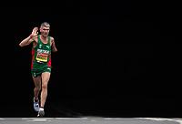 Manuel Mendes POR waves as he emerges from the Blackfriars Underpass in the T46 Men World Para Athletics Marathon Championships. The Virgin Money London Marathon, 28 April 2019.<br /> <br /> Photo: Jon Buckle for Virgin Money London Marathon<br /> <br /> For further information: media@londonmarathonevents.co.uk