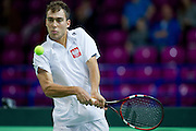 Jerzy Janowicz of Poland competes at men's single game during the BNP Paribas Davis Cup 2014 between Poland and Croatia at Torwar Hall in Warsaw on April 6, 2014.<br /> <br /> Poland, Warsaw, April 6, 2014<br /> <br /> Picture also available in RAW (NEF) or TIFF format on special request.<br /> <br /> For editorial use only. Any commercial or promotional use requires permission.<br /> <br /> Mandatory credit:<br /> Photo by &copy; Adam Nurkiewicz / Mediasport