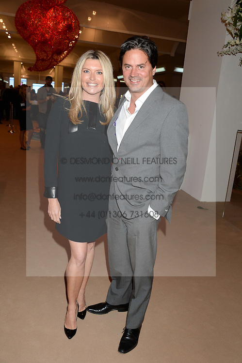 TINA HOBLEY and OLIVER WHEELER at the Masterpiece Midsummer Party in aid of Marie Curie Cancer Care held at The Royal Hospital Chelsea, London on 2nd July 2013.