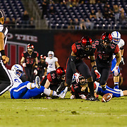 12 October 2018: San Diego State Aztecs safety Trenton Thompson (18) picks up the blocked punt and runs it back for a score in the second quarter. The San Diego State Aztecs lead 14-9 at the half against the Air Force Falcons at SDCCU Stadium Friday night.