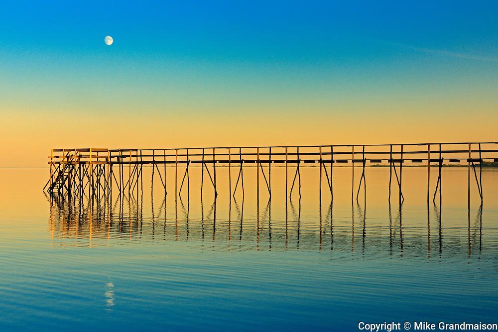 Pier on Lake Winnipeg with rising moon<br /> Matlock<br /> Manitoba<br /> Canada