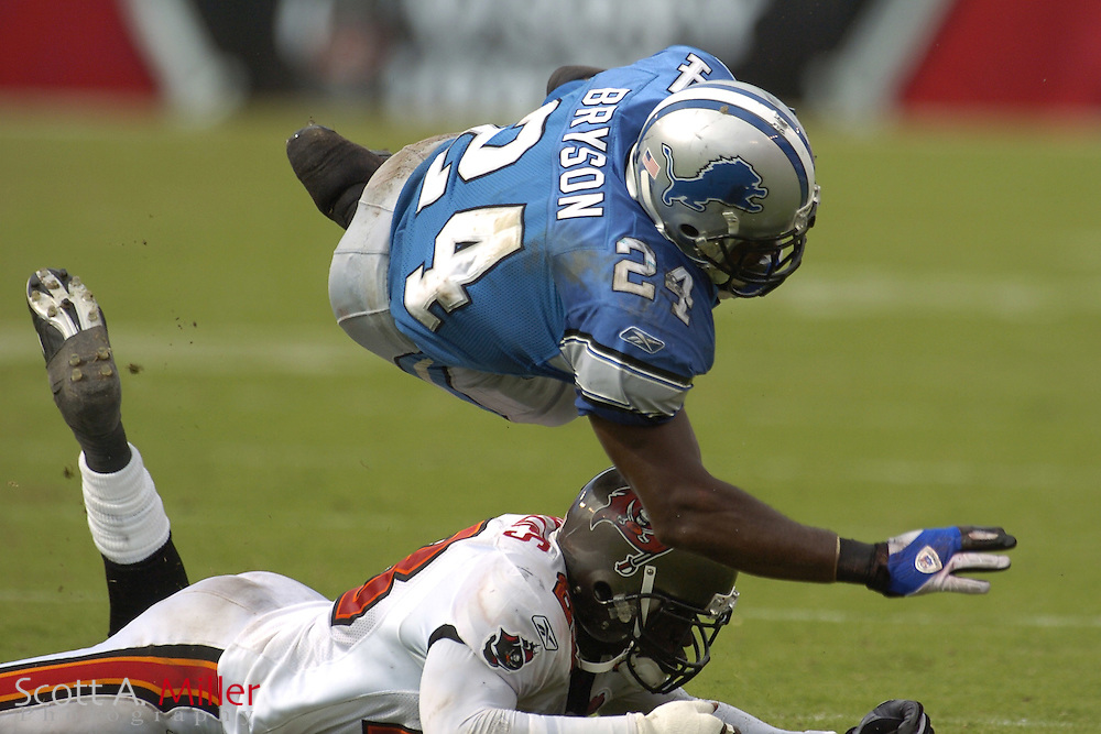 Oct. 5, 2005; Tampa, FL, USA; Detroit Lions running back #24 Shawn Bryson goes airborne after being hit by Tampa Bay Buccaneers defender Jermaine Phillips during the fourth quarter of the Bucs 17-13 win over the Lions at Raymond James Stadium.          ©2005 Scott A. Miller..©2005 Scott A. Miller