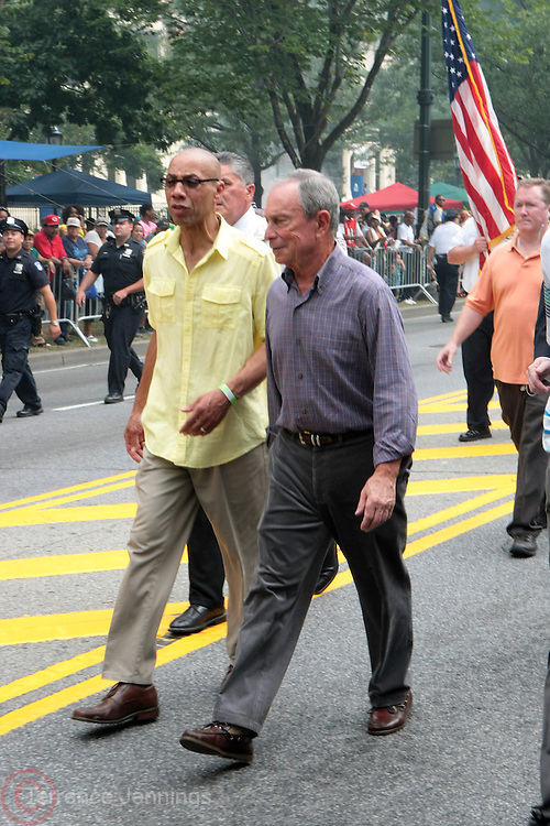 2 September 2013- Brooklyn, NY: (L-R) New York Schools Chancellor Derek Walcott and  New York City Mayor Michael Bloomberg attend the 46th Annual West Indian Day Parade held along Eastern Parkway held on September 2, 2013 in Brooklyn, NY  ©Terrence Jennings