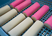Photo shows kamaboko products processed and packaged at the Oizen Shoten's  factory in Tome City, Miyagi Prefecture, Japan on 11 Sept. 2012.  On the right is  ?kohaku kamaboko,? a white loaf with a pink outer layer that is treated as a symbol of good fortune and a popular treat during New Year. Photographer: Robert Gilhooly