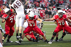 25 September 2010: Nick Bledsoe, Nathan Rebholz, and Chris Riley work to hold back Waylon Richardet, Mikel Ruder, and Terian Washington on a point after kick attempt.   The Missouri State Bears lost to the Illinois State Redbirds 44-41 in double overtime, meeting at Hancock Stadium on the campus of Illinois State University in Normal Illinois.