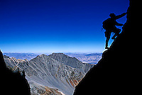 Doug Nurock climbing at dawn on Split Mountain in the John Muir Wilderness, CA.<br />