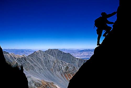 Doug Nurock climbing at dawn on Split Mountain in the John Muir Wilderness, CA.<br />