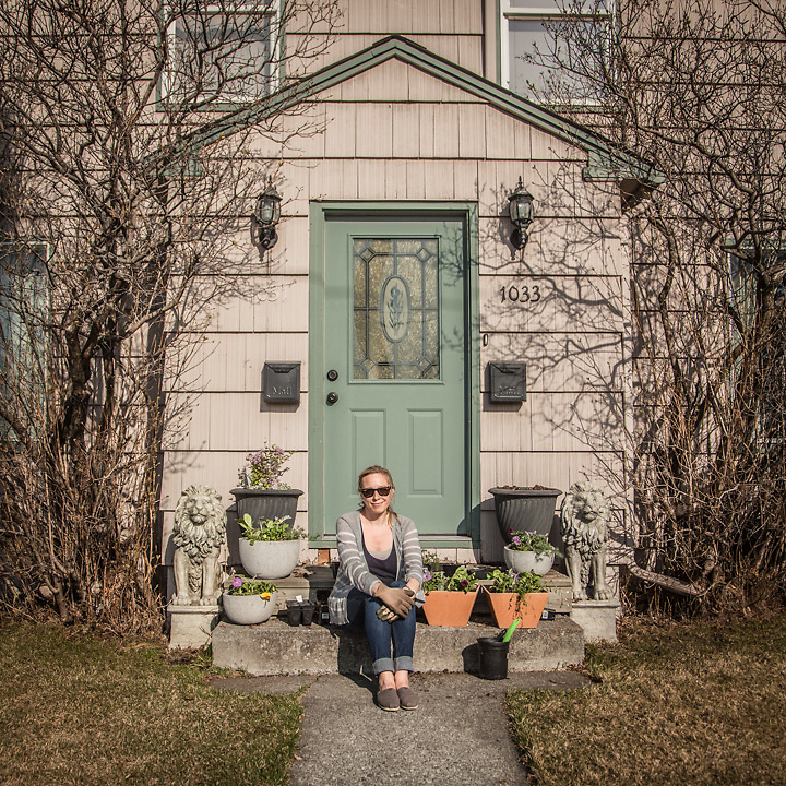 """Contract Coordinator for the Italian Oil Company ENI, Carrie Schnell prepares  flower boxes for the front of her home on E Street in Anchorage's South Addition neighborhood.  """"My boyfriend and I rent this home from my grandmother.  She has owned it forever."""""""