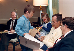 Bethesda, Maryland - May 5, 1991 -- United States President George H.W. Bush was greeted by two of his grandchildren, Sam and Ellie LeBlond in the Presidential Suite at Bethesda Naval Hospital in Bethesda, Maryland on May 5, 1991. The President was meeting with Chief of Staff John Sununu, right, and National Security Advisor Brent Scowcroft, left. Sam and Ellie are the children of the President's daughter, Dorothy.<br /> Photo by RWhite House/CNP/ABACAPRESS.COM