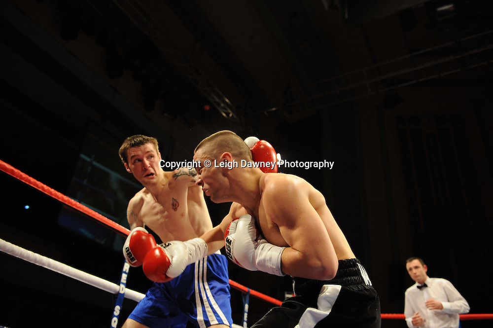 Joe Hughes (black shorts) defeats Jason Carr at The Troxy, Limehouse, London, 16th October 2010. Frank Maloney Promotions © Photo credit: Leigh Dawney
