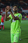 Peterborough Ryan Tafazolli (5) thanks the traveling fans  after winning the game 1-0 during the EFL Sky Bet League 1 match between Swindon Town and Peterborough United at the County Ground, Swindon, England on 21 January 2017. Photo by Gary Learmonth.