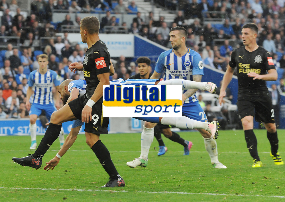 Football - 2017 / 2018 Premier League - Brighton & Hove Albion vs. Newcastle United<br /> <br /> Bruno of Brighton dives full length to foil Dwight Gayle of Newcastle at The Amex.<br /> <br /> COLORSPORT/ANDREW COWIE