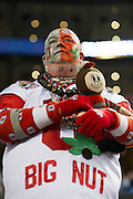 A fan of the Ohio State Buckeyes looks on during warmups before kickoff against the Oregon Ducks at the College Football Playoff National Championship Game at AT&T Stadium on January 12, 2015 in Arlington, Texas.  (Cooper Neill for The New York Times)