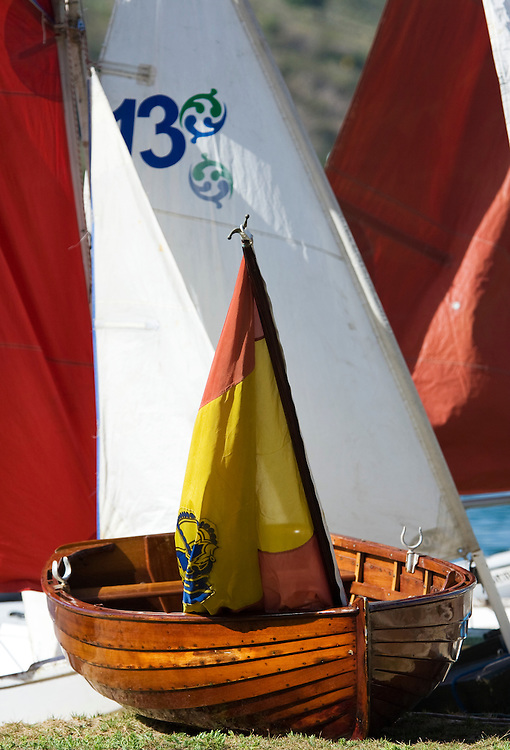 a varnished rowing dinghy with a Spanish flag during the 2008 Antigua Classic Yacht Regatta . This race is one of the worlds most prestigious traditional yacht races. It takes place annually off the cost of Antigua in the British West Indies. Antigua is a yachting haven, historically a British navy base in the times of Nelson.