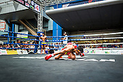 "28 JULY 2013 - BANGKOK, THAILAND:  A boxer performs the ""wai krua"" a pre bout ritual thanking his coaches and teachers during the ASEAN Muay Thai Championship at MBK shopping center in Bangkok.      PHOTO BY JACK KURTZ"