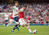 Football - 2019 / 2020 Premier League - Arsenal vs. Tottenham Hotspur<br /> <br /> Sokratis Papastathopoulos (Arsenal FC) clears in front of the on rushing Dele Alli (Tottenham FC) at The Emirates.<br /> <br /> COLORSPORT/DANIEL BEARHAM