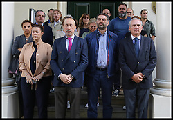 August 18, 2017 - London, London, United Kingdom - Image ©Licensed to i-Images Picture Agency. 18/08/2017. London, United Kingdom. Barcelona Terror Attack. Barcelona Terror Attack, Aftermath. Staff at the Spanish Embassy, London,  in observe a minutes silence following the terror attacks killing 13 and wounding over 100 people in the busy tourist street of Las Ramblas, Barcelona on Thursday 17th August involving Islamic militants using a van in the terror attack. Picture by Dinendra Haria / i-Images (Credit Image: © Dinendra Haria/i-Images via ZUMA Press)