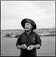 John King, retired former welder, who spends his days collecting golf balls from the bushes and cliff faces surrounding the Coast Golf Course in Malabar, Sydney, New South Wales, Australia. He then resells the balls to passing golfers to supplement his meagre pension. ..From a series titled: The Odd Ball