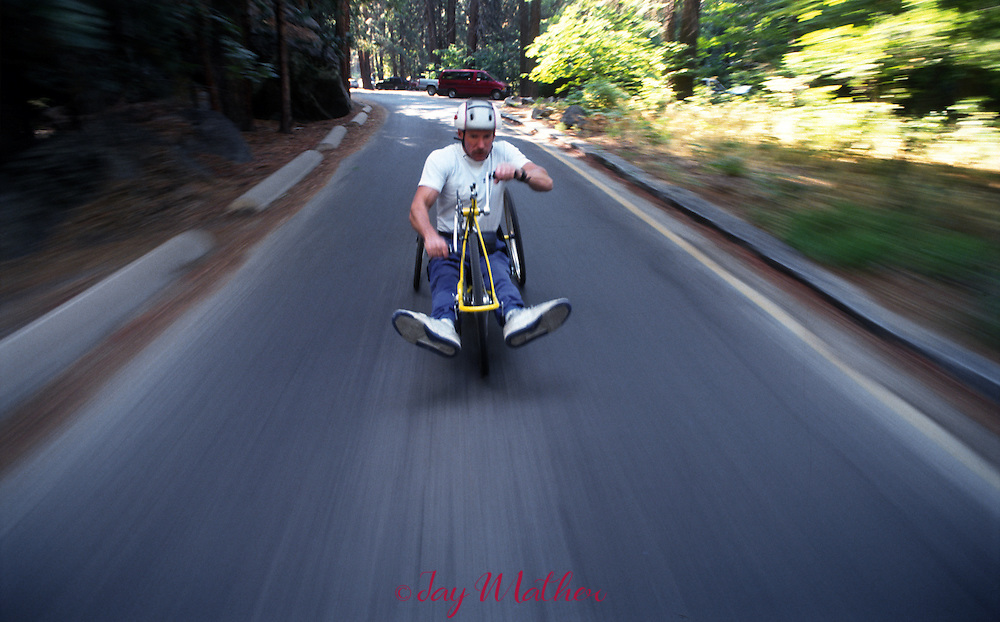 Mark Wellman uses a hand-crank three-wheeled cycle to train for his climb on Half Dome.  August 24, 1991