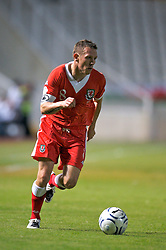 Nicosia, Cyprus - Saturday, October 13, 2007: Wales' captain Craig Bellamy in action against Cyprus during the Group D UEFA Euro 2008 Qualifying match at the New GSP Stadium in Nicosia. (Photo by David Rawcliffe/Propaganda)