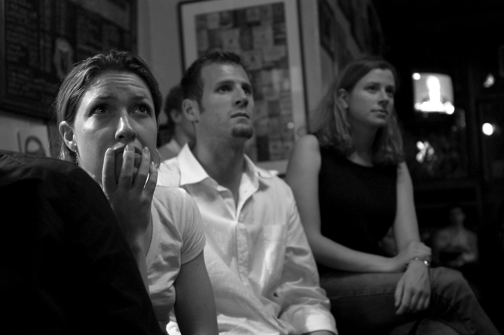 Young Democrats attend an all-night live broadcast of the 3rd and final presidential debate between George Bush and John Kerry at Carr's Irish Restaurant..Paris, France. 13 October 2004..Photo © J.B. Russell