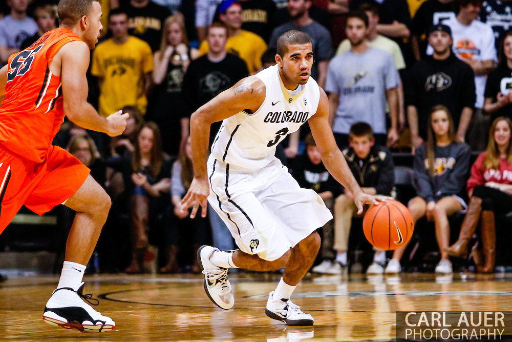January 2nd, 2014:  Colorado Buffaloes sophomore guard Xavier Talton (3) dribbles the ball up the court in the second half of the NCAA Basketball game between the Oregon State Beavers and the University of Colorado Buffaloes at the Coors Events Center in Boulder, Colorado