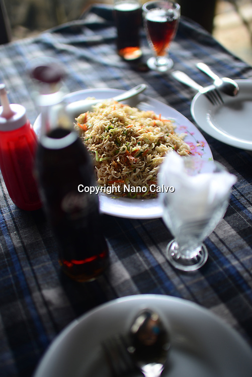 Noodles and sodas on restaurant table, Ahangama, Sri Lanka