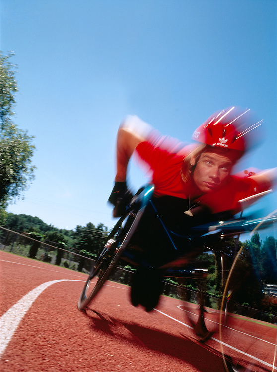 Parapalegic races wheelchair on track