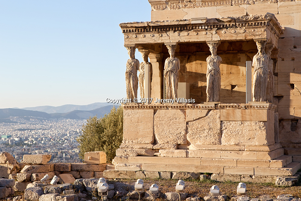 The Porch of Maidens of the Erechtheion in the Acropolis of Athens. The caryatids or korai, stand and seem to casually support the weight of the porch's roof on their heads.
