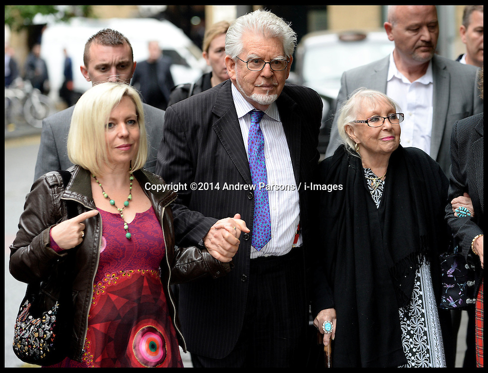 Rolf Harris arrives at Southwark Crown Court, London, United Kingdom, with His daughter (left) and his wife Alwen Hughes  (right glasses) he is expected to give evidence in his trial today. Tuesday, 27th May 2014. Picture by Andrew Parsons / i-Images