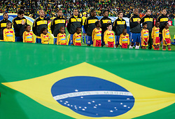Players of Brazil singing national anthem during the 2010 FIFA World Cup South Africa Group G match between Brazil and North Korea at Ellis Park Stadium on June 15, 2010 in Johannesburg, South Africa. Brazil defeated Korea 2-1. (Photo by Vid Ponikvar / Sportida)