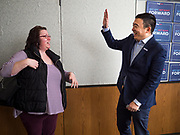 """22 JANUARY 2020 - CHARLES CITY, IOWA: ANDREW YANG approaches a woman for a """"high five"""" at a campaign event in the public library in Charles City, IA. Yang, an entrepreneur, is running for the Democratic nomination for the US Presidency in 2020. He is in northern Iowa as a part of his 17 day bus tour across the state. Iowa hosts the the first election event of the presidential election cycle. The Iowa Caucuses will be on Feb. 3, 2020.         PHOTO BY JACK KURTZ"""