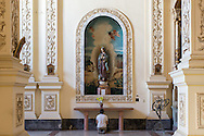 A woman prays inside la Iglesia de San Agustín o San Francisco el Nuevo in Havana, Cuba on 17 Dec 2015