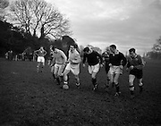 Irish Rugby Football Union, Ireland v Australia, Tour Match, Australian and Irish team practice in College Park, Dublin, Ireland, Tuesday 14th January, 1958,.14.1.1958, 1.14.1958,..Irish Team, ..P J Berkery, Wearing number 15 Irish jersey, Full back, Landsdowne Rugby Football Club, Dublin, Ireland, and, London Irish Rugby Football Club, Surrey, England, ..A J F O'Reilly, Wearing number 14 Irish jersey, Right Wing, Old Belvedere Rugby Football Club, Dublin, Ireland, ..N J Henderson, Wearing number 13 Irish jersey, Captain of the Irish team, Right centre, N.I.F.C, Rugby Football Club, Belfast, Northern Ireland, ..D Hewitt, Wearing number 12 Irish jersey, Left centre, Queens University Rugby Football Club, Belfast, Northern Ireland,. .A C Pedlow, Wearing number 11 Irish jersey, Left wing, C I Y M S Rugby Football Club, Belfast, Northern Ireland, ..J W Kyle, Wearing number 10 Irish jersey, Stand Off, N.I.F.C, Rugby Football Club, Belfast, Northern Ireland, ..A A Mulligan, Wearing number 9 Irish jersey, Scrum Half, Cambridge University Rugby Football Club, Cambridge, England, and, London Irish Rugby Football Club, Surrey, England, ..B G M Wood, Wearing number 1 Irish jersey, Forward, Garryowen Rugby Football Club, Limerick, Ireland, ..R Dawson, Wearing number 2 Irish jersey, Forward, Wanderers Rugby Football Club, Dublin, Ireland, ..P J O'Donoghue, Wearing  Number 3 Irish jersey, Forward, Bective Rangers Rugby Football Club, Dublin, Ireland,  ..W A Mulcahy, Wearing number 4 Irish jersey, Forward, University College Dublin Rugby Football Club, Dublin, Ireland,..J B Stevenson, Wearing number 5 Irish jersey, Forward, Instonians Rugby Football Club, Belfast, Northern Ireland,..J A Donaldson, Wearing number 6 Irish jersey, Forward, Collegians Rugby Football Club, Belfast, Northern Ireland,..J R Kavanagh, Wearing number 7 Irish jersey, Forward, Wanderers Rugby Football Club, Dublin, Ireland, ..N Murphy, Wearing number 8 Irish jersey, Forward, Cork Constitution Rugby Football C