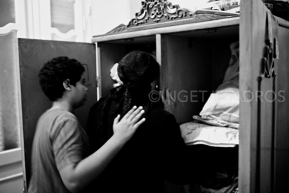 Mekarius (L) comforts his mother (Sanaa) in Medo's bedroom. Nag Hamadi, Egypt.