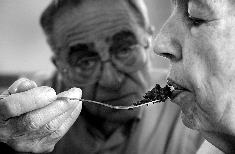 Joseph Morone feeds his wife Mary Alice at Americare Nursing Home in Westfield, Ind.  Mary Alice has been suffering from Alzheimers for years and Joseph has been visiting his wife every day, helping her with meals.