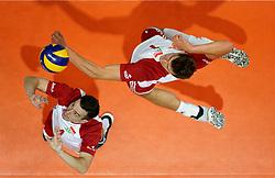 23-09-2019 NED: EC Volleyball 2019 Poland - Germany, Apeldoorn<br /> 1/4 final EC Volleyball Poland win 3-0 / Piotr Nowakowski #1, Marcin Komenda #4 of Poland