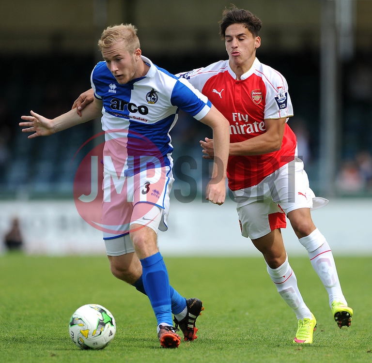 Danny Greenslade of Bristol Rovers is challenged by Arsenal's Savvas Mourgos - Photo mandatory by-line: Dougie Allward/JMP - Mobile: 07966 386802 - 18/07/2015 - SPORT - Football - Bristol - Memorial Stadium - Pre-Season Friendly