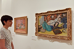"© Licensed to London News Pictures. 01/08/2017. London, UK. A staff member views (L to R) ""Reclining Odalisque"", 1926, and ""Two Models Resting"", 1928.  Preview of ""Matisse in the Studio"", at the Royal Academy of Arts, Piccadilly, the first exhibition to consider how the personal collection of treasured objects of Henri Matisse were both subject matter and inspiration for his work.  Around 35 objects are displayed alongside 65 of Matisse's paintings, sculptures, drawings, prints and cut-outs.  The exhibition runs 5 August to 12 November 2017.  Photo credit : Stephen Chung/LNP"