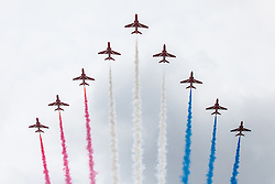 © Licensed to London News Pictures. 11/06/2016. London, UK. The Royal Air Force's Red Arrows fly low over Pall Mall leaving their signature red, white and blue smoke trail, to conclude Trooping the Colour. Trooping the Colour, a military parade of the Queen's Household Division, takes place annually and this year marks Her Majesty's  official 90th birthday. Photo credit: Rob Pinney/LNP