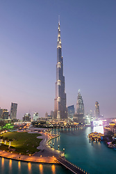 View of Burj Khalifa and lake at dusk in Downtown Dubai United Arab Emirates