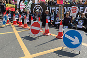 Climate Change protestors with Extinction Rebellion block Edgeware Road and simultaneously stop traffic across central London including Marble Arch, Piccadilly Circus, Waterloo Bridge and roads around Parliament Square, on 15th April 2019, in London, England.