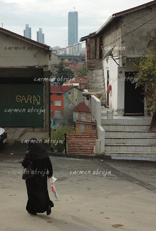 veiled woman in the Armutlu district with view of Levent skylines in the background
