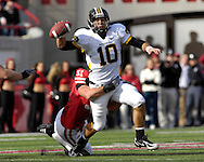 University of Missouri quarterback Chase Daniel (10) gets pressured out of the pocket by Nebraska linebacker Bo Ruud (51) in the fourth quarter at Memorial Stadium in Lincoln, Nebraska, November 4, 2006. The Huskers beat the Tigers 34-20.<br />